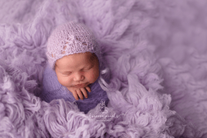 Baby gir on pruple floakati photo