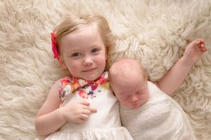Sibling posed