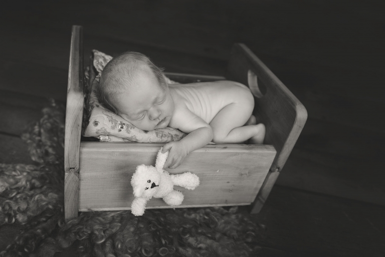 baby on bed with teddy
