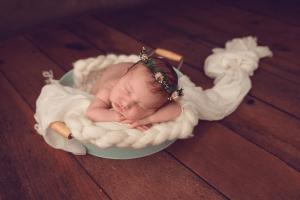 Newborn baby in prop - vintage
