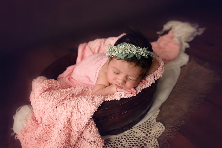 newborn baby girl in bowl